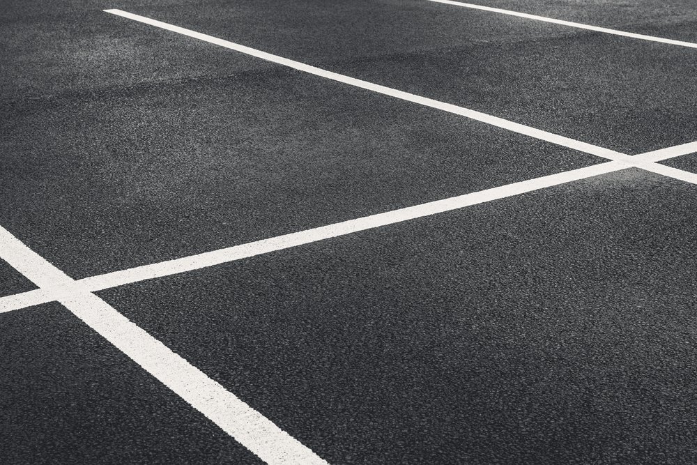 Image of a Freshly painted parking lot line markings shot at an angle