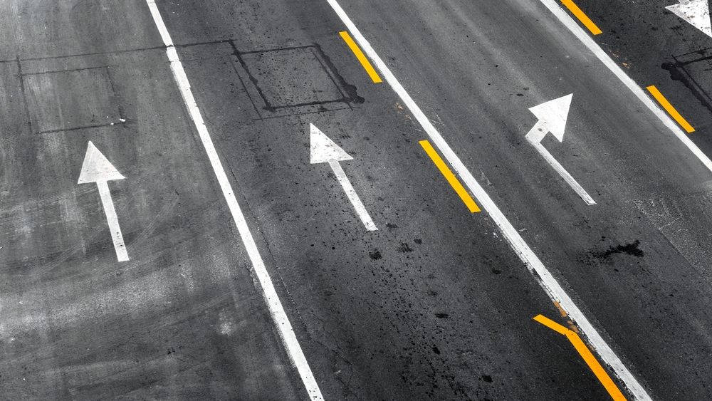 Asphalt Road Surface with tire marks on road closeup, Image by CJJ Services