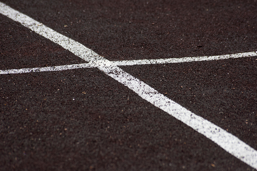 White markings on an asphalt road surface, Image by CJJ Services